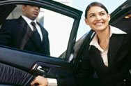 Woman exiting chauffeur's car (Image)